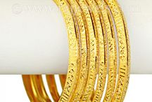 """Striking Gold """"Bangles"""" / #Gold #bangles are the most essential #accessory of every #woman's #jewelry wardrobe.  It can take your outfit from ho-hum to wow in a matter of seconds.  Whether worn #traditionally in a #Indian #wedding or glammed up for a special occasion these #22k #gems are an investment piece you can keep for a #lifetime. Explore the #bangle #sets collection at: https://www.rajjewels.com/jewelry-jewellery/bangles/gold-bangles.html"""