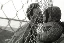Fence Kiss / A kiss is the most meaningful and emotionally expressive in all of man's actions and gestures. It serves people to keep each others relationship and intimacy or heals pain and ease anguish.