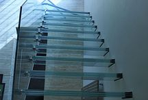 Ledborough - Glass Staircase / It has the floating staircase experience that makes it a fascinating creation. It was totally unique in design because the cantilevered treads and the glass balustrade are connected using only one fixing per tread. The treads are constructed using a special high duty laminating process that can withstand the loads imposed, and enable the whole structure to have a transparent appearance.
