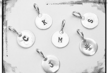 What's in a name? / Personalized necklaces, pendants, & rings.