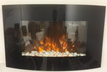 Black Glass TruFlame Wall Mounted Electric Fires with Pebbles (88 wide) / Here you will find images of our black glass wall mounted electric fires with pebble fuel effect and trademarked TruFlame effect.