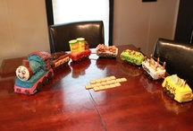 Jonah's Thomas the Train Cake (3rd birthday) / I made this cake for Jonah's birthday. I used a loaf pan and cup cakes to shape the engine, and mini loaf pans made the right shape and size for the different train cars, decorated with different themes based on candy I found at the dollar store.