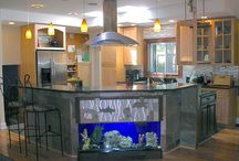 Eclectic Kitchen design / An eclectic kitchen designed around a fish tank in the countertop