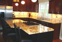 Columbus Traditional Kitchen Remodel / This beautiful kitchen in Columbus,Ohio features an island with seating, granite countertops, painted kitchen cabinets, tile backsplash, stainless steel appliances and hardwood flooring.