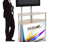 Monitor Kiosks / Kiosk counter displays are perfect for trade show displays or POP displays and can be used as an informative computer display or monitor display center. Add graphics to personalize your kiosk counter. Portable Kiosks allow you to take them on the go.