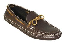 Arrow Moccasins / In the tradition of the North American Indian, Arrow Moccasins are made by hand, one pair at a time using heavy Swiss cowhide tanned by England's finest bridle leather producers.  The moccasins conform to your feet over time, providing a custom fit that will last for years.