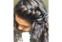 Cute hairstyles / Curly hair with a twist added with a bow