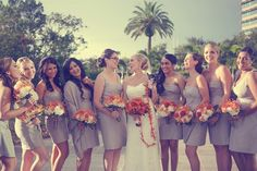 bridesmaids in grey with orange + white flower bouquets | The Big Fat Indian Wedding Florida | Carrie Wildes Photo