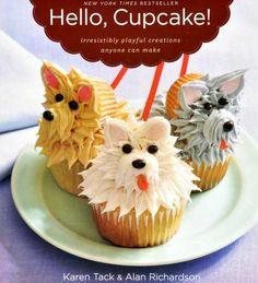 A cupcake book that looks like such fun! Picture on front is Two cupcakes that are designed as Dog Faces