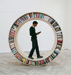 *Groovy,baby!! XD* [this looks as if it came from the set of 'A Clockwork Orange'?]  The Circular Walking Bookshelf is part of the Archive Series by David Garcia.  The Archive Series are investigations on space and books. Its departure point is density and micro spaces, and a series of traditional relationships that humans have to books.    The Circular Walking Bookshelf known as Archive II is owned and on exhibition at the University of Roskilde Main Library.