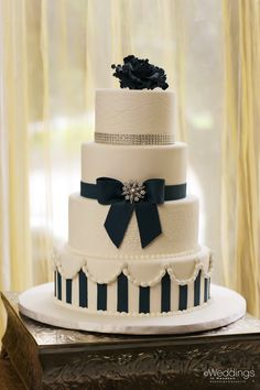 Classic white and navy blue accented wedding cake ~ Dream Cakes ~ Photo: D. Jones Photography