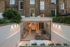 Rydon Street is a minimal home located in London, United Kingdom, designed by Moxon Architects. This project carefully inserts a completely modern living space within a sensitively restored traditional Victorian terraced house in Islington, London. Chosen for its south facing garden, the tall yet narrow building was oppressively cellular and disconnected from the rear garden, both factors at odds with the client's lifestyle.