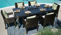 """The Via Collection 6-Person All Weather Wicker Patio Furniture Dining Set by Open Air Lifestyles, LLC. $2545.46. The Via All Weather Wicker Collection dining set is the perfect addition for those people who entertain often or have large family gatherings. It accomodates 6 people easily, also giving your outdoor area an upscale look for years to come. It is shown in the Viro wicker color Prussian Dark Bronze and comes with 3"""" thick Sunbrella fabric Canvas Canvas cushions w..."""