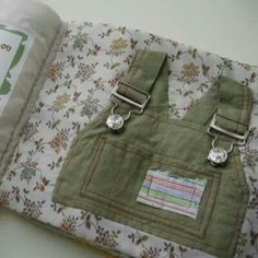 Make a book with old clothes for kids to practice zipping,  buckling,  buttoning, etc!! Love this!!