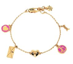 """Juicy Couture Love Always Charm Bracelet. A waspy chain frames a gorgeous gold toned heart while tiny charms dance along the bracelet. 'Love Always' and signature Juicy logo's are stamped on various charms for an enamoring aesthetic. Lobster clasp closure. Imported 83% Brass Metal, 10% Epoxy, 4% Steel, 2% Glass, 1% Cubic Zirconia Chain Length 7.5""""."""