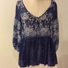 Urban outfitters like new -flowery top .worn once. Waisted blue and white top Urban Outfitters Tops Blouses