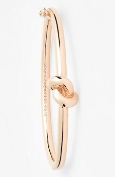 How cute is this knotted rose gold Kate Spade bangle?