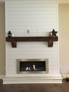 Shiplap Bioethanol Fireplace with rustic beam mantle