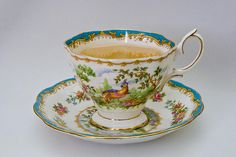 traditional tea China pattern ( Looks like mixed flowers on plate and potentially a guinea fowl on the cup)