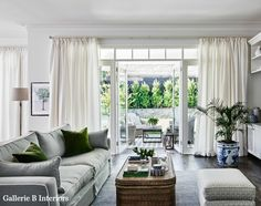 My Hamptons style living room and new sheer linen curtains. Photo by Lisa Cohen Photography.