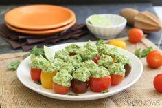 Bite-size guacamole stuffed tomatoes
