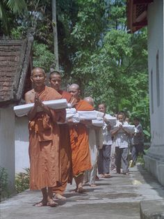 #Manuscript procession Monks and laypeople carrying newly preserved manuscripts around the monastery before storage. Vat Sang Khong, Luang Prabang District, 1999.