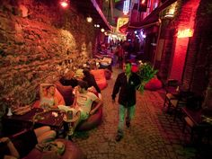 "Istanbul Nightlife Visitors lounge outside cafés and bars near the Ortakoy Mosque in Istanbul. ""Istanbul is the center of a country that is 98 percent Islamic yet increasingly famous for its watermelon martinis,"" notes author Pico Iyer. ""Foreigners come to Istanbul for what is Turkish about the place. Turks are drawn here by what's cutting-edge and international."" For more, read ""Istanbul: City of the Future"" from the October 2010 issue of National Geographic Traveler."