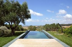 Slate-covered walls frame this swimming pool created by architecture studio LAD in the grounds of an Italian villa.