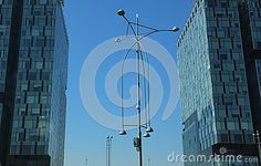 Photo about Lights corps between two office buildings - street lighting. Image of tower, architectural, lights - 78091284 Office Buildings, Photo Lighting, Construction, Technology, Stock Photos, Lights, Street, City, Image