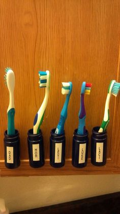 Toothbrush holders. Inspired by a pin that had you buy containers. I have more than my share of prescription bottles so I took the labels off, used Velcro to attach the bottles to the inside of the mirror door. Velcro so that you can take them off and clean them if needed. Then I used my favorite organizational tool, the label maker to put the names on.