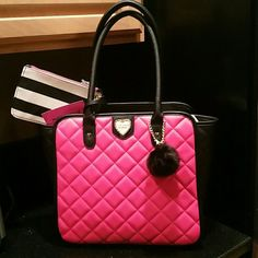 BETSEY JOHNSON Tote w/wristlet fushia Large BJ Tote - fushia and black winged style. It has a trendy puff ball attached to front.Gold hardware. Attached wristlet. Gold heart on front. Gorgeous signature BJ lining - maroon and pink lips. Brand new with tags. Betsey Johnson Bags Totes