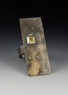 Ring by Roger Rimel.........Connie Fox: The yellow stone calls us in.
