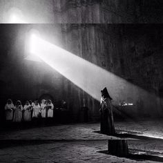 Photo: Seeing the Light by Bruce Haley.  An Armenian orthodox priest reciting the liturgy in a 13th-century monastery in Nagorno-Karabakh.