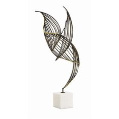 Natural iron with brass welds, this abstract winged sculpture sits atop a solid white marble base.