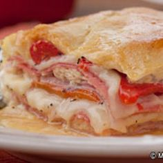 Italian Layer Bake Casserole: like a hot Italian sub in casserole form. Italian Layer Bake is a Mediterranean delight. This recipe features layers of Italian meats, peppers, and bubbly cheese under a golden crust. Food For Thought, Think Food, I Love Food, Good Food, Yummy Food, Tasty, Great Recipes, Dinner Recipes, Favorite Recipes