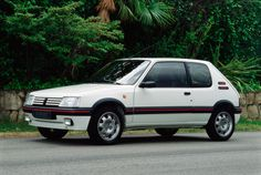 Arguably the most famous non-GTI Volkswagen is this, the Peugeot 205 GTI. Peugeot has used the GTI moniker for a variety of hot hatchbacks, but the 205 GTI is a legend. Some say it's the best hot hatch of all time. Auto Peugeot, Peugeot 205, Renault 5 Gt Turbo, Car Guide, Volkswagen Polo, Performance Cars, Rally Car, Retro Cars, Motor Car