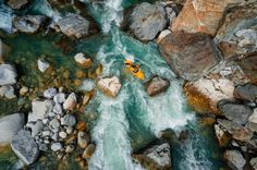 Kayaking, Outdoor, Sports - Aerial view of a kayaker in a Swiss river.