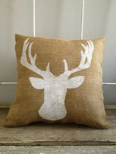 Deer head Burlap Pillow. DIY this w/ some burlap or linen, a stencil, & fabric paint.