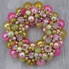 Faded Pink and Gold Christmas Ornament Wreath with Vintage Polish Indents and Shiny Brites. http://thehauntedlamp.com