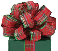 Great bow!   I love doing these great bows on packages!   They make the box  so beautiful