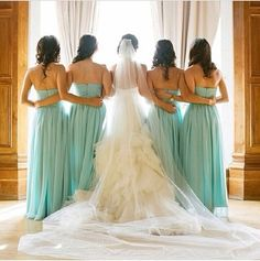 The bridal party in mint wedding dresses