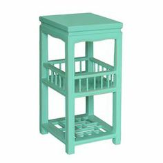 Showcasing a weathered turquoise finish and 2 display shelves, this eclectic end table adds a pop of color to your living room or master suite.  J&M ($211)