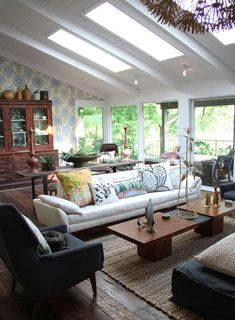 Modern & Rustic furnishings combine to create a crisp - yet comfortable space.  Love the exposed beams & skylights.