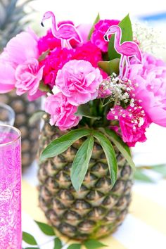 When it comes to DIY decor, making your centerpieces is easy! Simply carve out a pineapple and fill it with water. Then add flowers such as carnations, hydrangeas, daisies, baby's breath, and place each on top of your reception tables with a pink or palm-inspired tablecloth. - See more at: http://www.quinceanera.com/decorations-themes/a-tropical-fun-flamingo-quinceanera-theme/#sthash.DQ6Sd3u0.dpuf