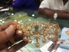 23 grams stunning stone armlet (Bajubandh) from Premraj Shantilal Jain Jewellers. The armlet is embellished with rubies, emeralds and pearls. Antique Jewellery Designs, Gold Jewellery Design, Diamond Jewellery, Gold Necklace Simple, Gold Jewelry Simple, Jewelry Patterns, Indian Jewelry, South India, Jewelry Sets