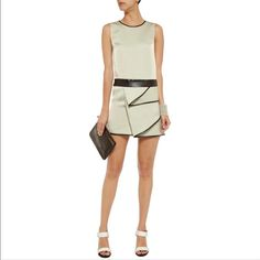 NWT Phillip Lim Sage Faux Leather Faille Dress S Faille. Tiered ruffle, black faux leather trims. Concealed hook and zip fastening at back. 80% triacetate, 20% polyester; trim: 100% polyurethane. Dry clean. Designer color: light sage. Fits true to size, take your normal size. Cut for a slightly loose fit. Mini-length. Mid-weight non-stretchy fabric. MSRP: $695, new with tags. US size 2 3.1 Phillip Lim Dresses Mini