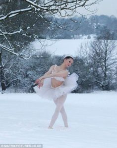 Dancing in the Snow ~  Snow queen: English ballerina Rebecca Sewell is pictured dancing in deep drifts in Barnet, north London
