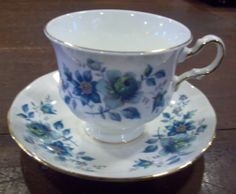 Queen Anne Bone China Made in England Floral Tea Cup and Saucer Gilded
