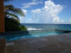 Take a dip in the fresh water pool overlooking the Caribbean.  Staying here on my vacation in St. Croix!  So excited!