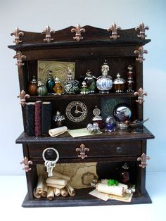 miniature witchy hutch.. want for my dream dollhouse!